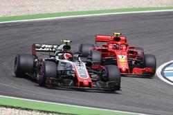 Kevin Magnussen, Haas F1 Team VF-18, leads Kimi Raikkonen, Ferrari SF71H