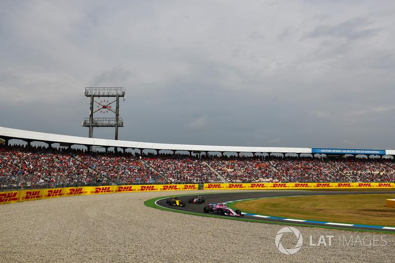 Esteban Ocon, Force India VJM11, leads Carlos Sainz Jr., Renault Sport F1 Team R.S. 18, and Kevin Magnussen, Haas F1 Team VF-18