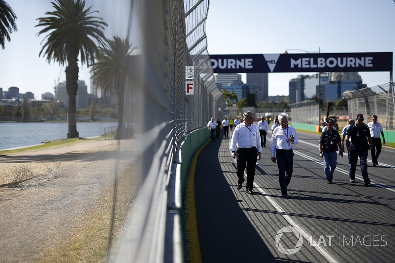 Charlie Whiting, FIA Delegate walks the track