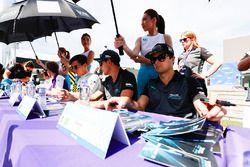 Nelson Piquet Jr., Jaguar Racing, signs autographs for fans