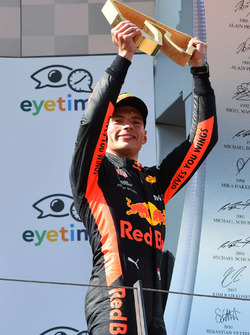 Race winner Max Verstappen, Red Bull Racing celebrates on the podium with the trophy