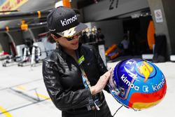 Actress Carina Lau with the helmet of Fernando Alonso, McLaren
