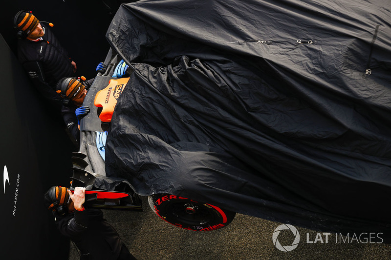 The McLaren MCL33 of Fernando Alonso is returned to the pits