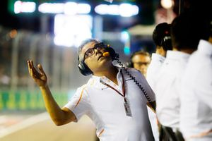 Gil de Ferran, Sporting Director, McLaren, checks for rain fall in the pit lane