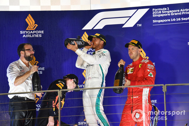 Max Verstappen, Red Bull Racing, Lewis Hamilton, Mercedes AMG F1 and Sebastian Vettel, Ferrari celebrate on the podium with the champagne