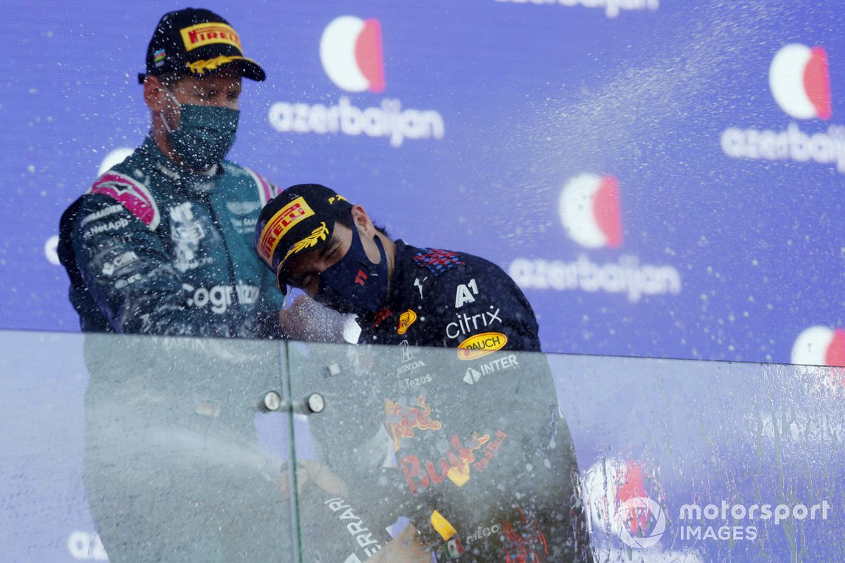 Podium: second place Sebastian Vettel, Aston Martin, race winner Sergio Pérez, Red Bull Racing