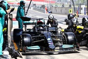 Lewis Hamilton, Mercedes W12, leaves his pit box after a stop