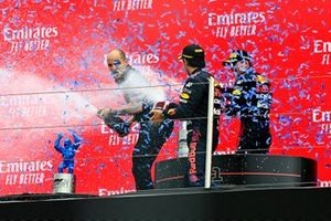 Gianpiero Lambiase, Race Engineer, Red Bull Racing, Sergio Perez, Red Bull Racing, 3rd position, and Max Verstappen, Red Bull Racing, 1st position, spray Champagne on the podium