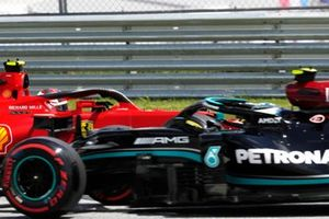 Charles Leclerc, Ferrari SF21, and Valtteri Bottas, Mercedes W12