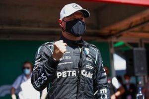 Valtteri Bottas, Mercedes, celebrates after securing pole
