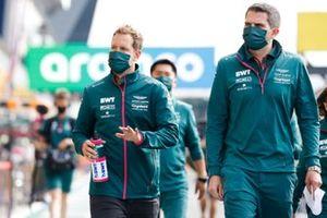 Sebastian Vettel, Aston Martin, and colleagues in the pit lane
