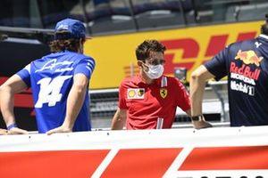 Fernando Alonso, Alpine F1, and Charles Leclerc, Ferrari,