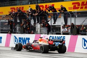 Max Verstappen, Red Bull Racing RB16B, crosses the line to win the race