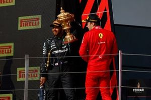 Lewis Hamilton, Mercedes, 1st position, with the original trophy, and Charles Leclerc, Ferrari, 2nd position, on the podium