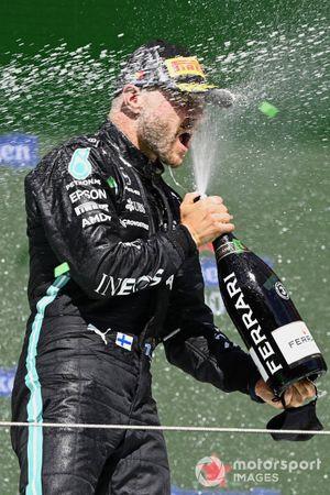 Valtteri Bottas, Mercedes, 3rd position, sprays Champagne on the podium