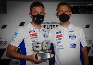 Team Manager Florian Prüstel and Team Owner Ingo Prüstel with the trophy marking the number 50 retirement