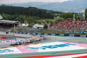 Fernando Alonso, Alpine A521, leadsKimi Raikkonen, Alfa Romeo Racing C41 , Mick Schumacher, Haas VF-21, and Nicholas Latifi, Williams FW43B