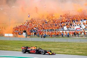 Max Verstappen, Red Bull Racing RB16B, 1st position, waves to his fans on his way to Parc Ferme