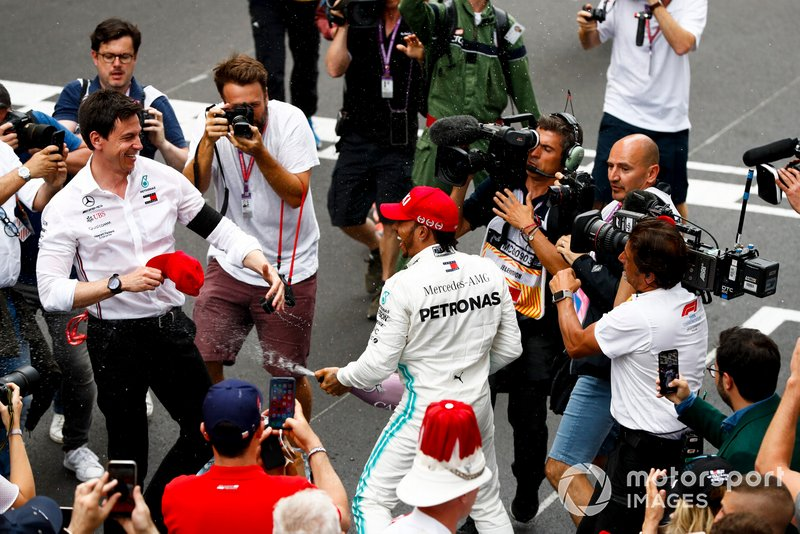 Lewis Hamilton, Mercedes AMG F1, 1st position, sprays Champagne at Toto Wolff, Executive Director (Business), Mercedes AMG