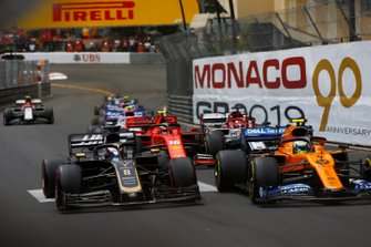 Lando Norris, McLaren MCL34, leads Romain Grosjean, Haas F1 Team VF-19, Charles Leclerc, Ferrari SF90, Kimi Raikkonen, Alfa Romeo Racing C38, and the remainder of the field at the start