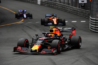 Pierre Gasly, Red Bull Racing RB15, leads Carlos Sainz Jr., McLaren MCL34, and Daniil Kvyat, Toro Rosso STR14