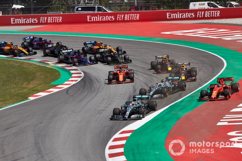 Lewis Hamilton, Mercedes AMG F1 W10, leads Valtteri Bottas, Mercedes AMG W10, Sebastian Vettel, Ferrari SF90,Max Verstappen, Red Bull Racing RB15, Charles Leclerc, Ferrari SF90, and the rest of the field in the first corner