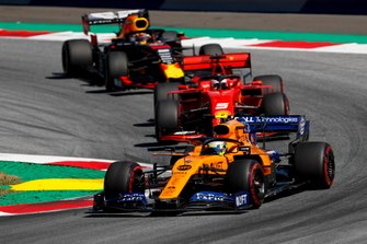 Lando Norris, McLaren MCL34 leads Sebastian Vettel, Ferrari SF90 and Max Verstappen, Red Bull Racing RB15