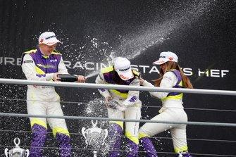 Jamie Chadwick celebrates on the podium with Alice Powell and Marta Garcia