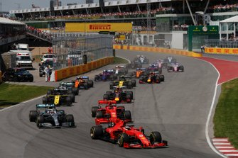 Sebastian Vettel, Ferrari SF90 leads Lewis Hamilton, Mercedes AMG F1 W10 and Charles Leclerc, Ferrari SF90 at the start of the race