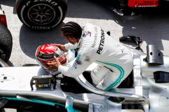 Lewis Hamilton, Mercedes AMG F1, 1st position, climbs out of his car in Parc Ferme
