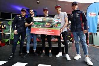 Max Verstappen and Pierre Gasly give the Red Bull Pit Stop winners a year's supply of fuel