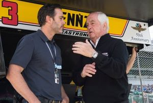 NASCAR driver Jimmie Johnson talks to Roger Penske, Team Penske Chevrolet