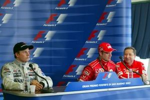 Kimi Raikkonen, McLaren, Rubens Barrichello, Ferrari with Jean Todt, Ferrari General Manager, who substitited for race winner Michael Schumacher, Ferrari in the press conference