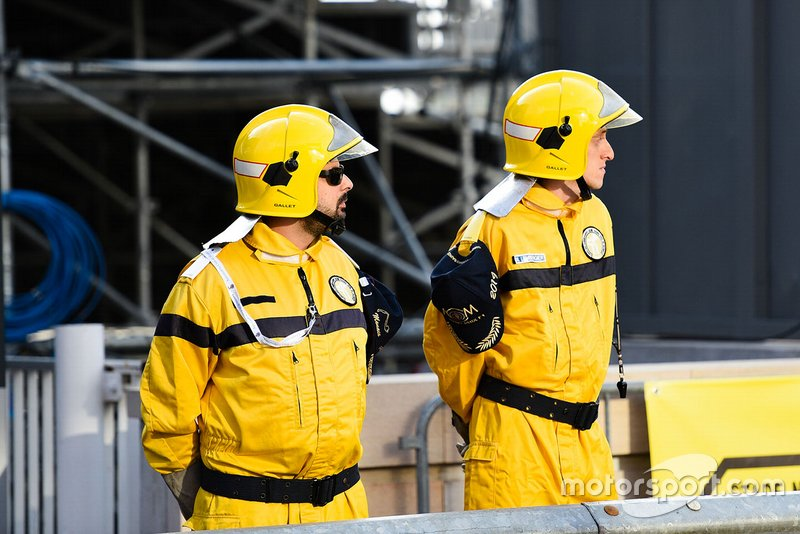 Marshals in the pit lane