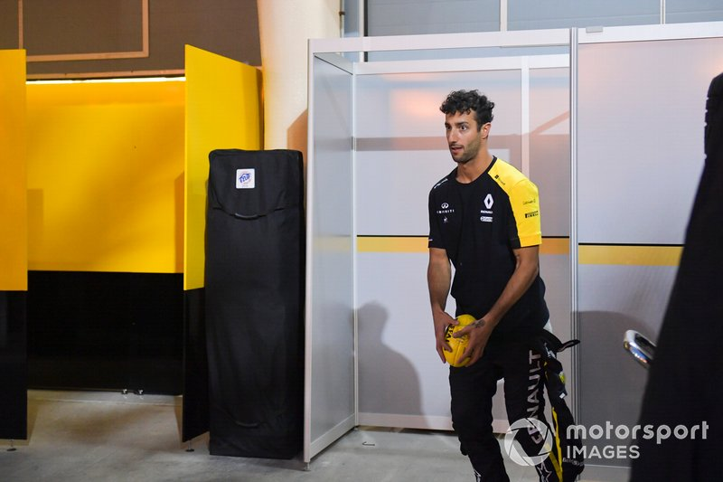 Daniel Ricciardo, Renault F1 Team plays with Aussie Rules football at the back of the garage