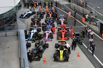 The cars and mechanics in Parc Ferme after the race