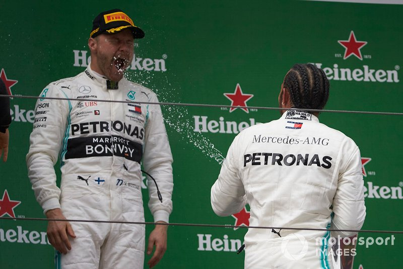 Valtteri Bottas, Mercedes AMG F1, 2nd position, is sprayed by Lewis Hamilton, Mercedes AMG F1, 1st position, with Champagne