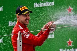 Sebastian Vettel, Ferrari, 3rd position, celebrates with Champagne on the podium
