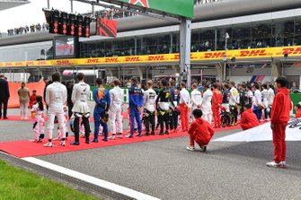 The drivers on the grid for the national anthem
