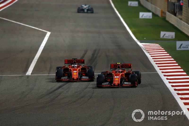 Sebastian Vettel, Ferrari SF90, battles with Charles Leclerc, Ferrari SF90