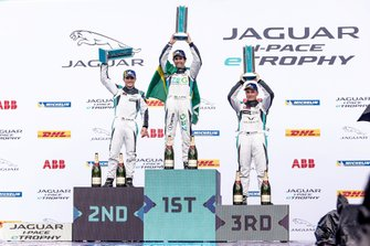 Sérgio Jimenez, 1st position, Bryan Sellers, 2nd position, Simon Evans, 3rd position, celebrate on the podium