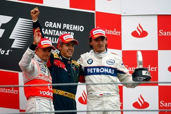 Podium: second place Heikki Kovalainen, McLaren, Race winner Sebastian Vettel, Toro Rosso, third place Robert Kubica, BMW Sauber