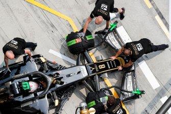 Romain Grosjean, Haas F1 Team VF-19, is returned to the garage