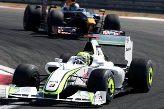 Jenson Button, Brawn Grand Prix BGP 001 leads Sebastian Vettel, Red Bull Racing RB5