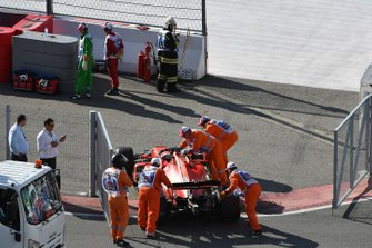 Marshals move the car of Sebastian Vettel, Ferrari SF90