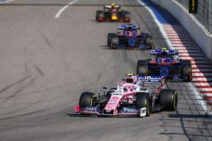Lance Stroll, Racing Point RP19, leads Pierre Gasly, Toro Rosso STR14, Daniil Kvyat, Toro Rosso STR14, and Alex Albon, Red Bull RB15