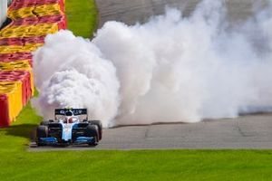 Robert Kubica, Williams FW42, parks up with technical issues and a large plume of smoke