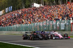 Sergio Perez, Racing Point RP19, leads Kevin Magnussen, Haas F1 Team VF-19 and Pierre Gasly, Toro Rosso STR14