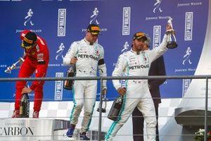 Lewis Hamilton, Mercedes AMG F1, 2nd position, Valtteri Bottas, Mercedes AMG F1, 3rd position, and Charles Leclerc, Ferrari, 1st position, leave the podium