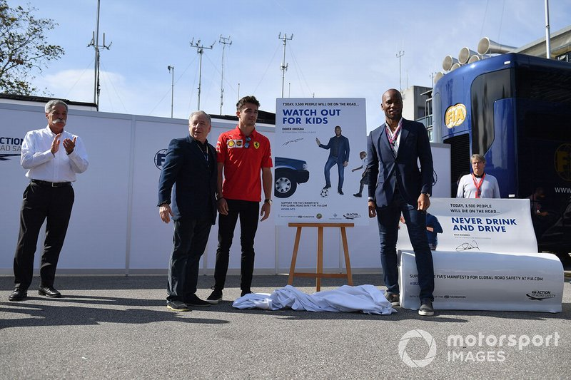 Jean Todt, President, FIA, Charles Leclerc, Ferrari, and Footballer Didier Drogba unveil a poster at a safer driving campaign